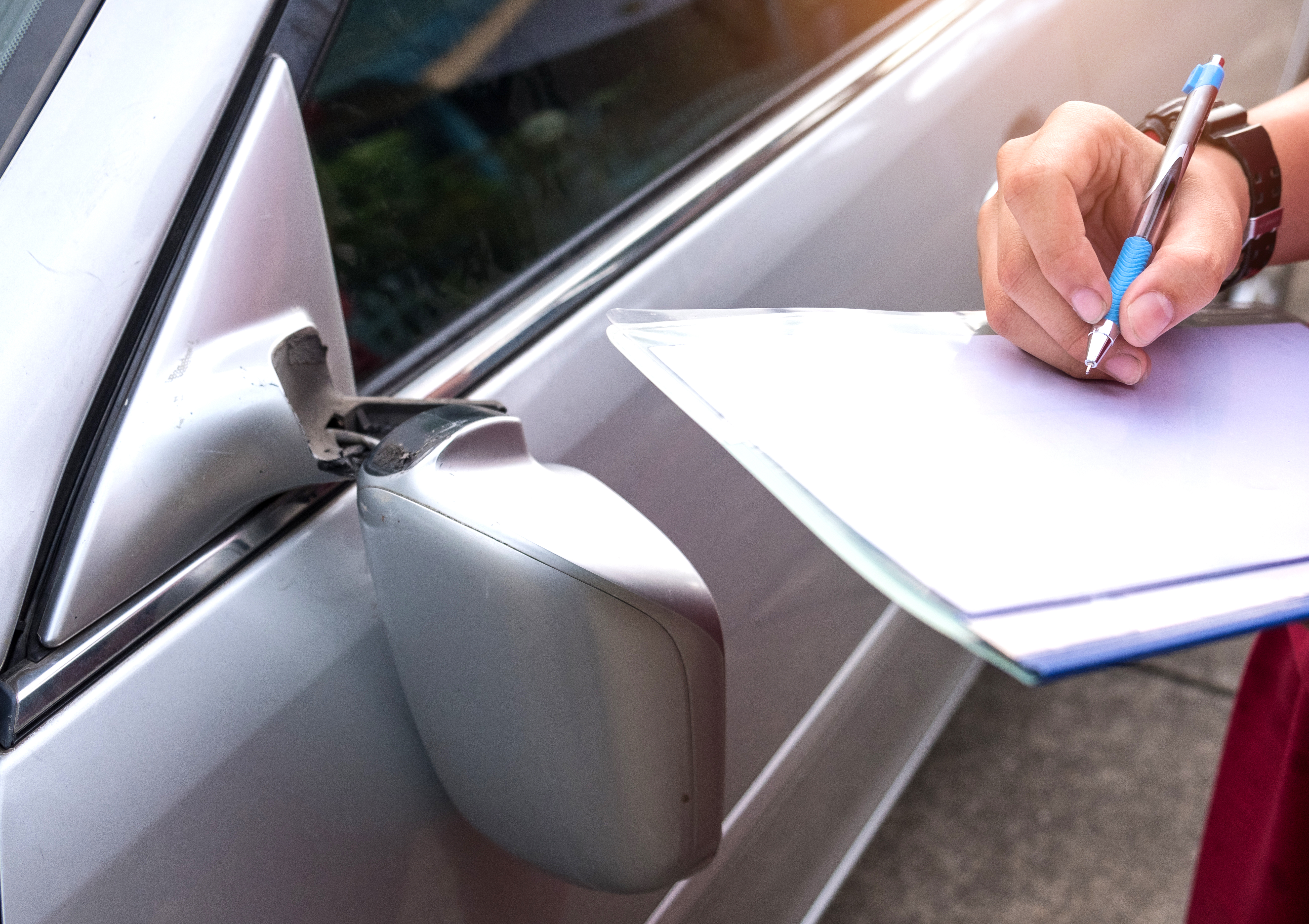 Insurance officer writing notes after an accident